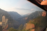 Montegrin mountain ranges with the last sunrays reflecting the passengers in the window